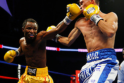 Dec 11, 2008; Newark, NJ, USA; Joseph Agbeko and William Gonzalez trade punches during their 12 round bout at the Prudential Center. Agbeko retained the belt via 12 round majority decision.