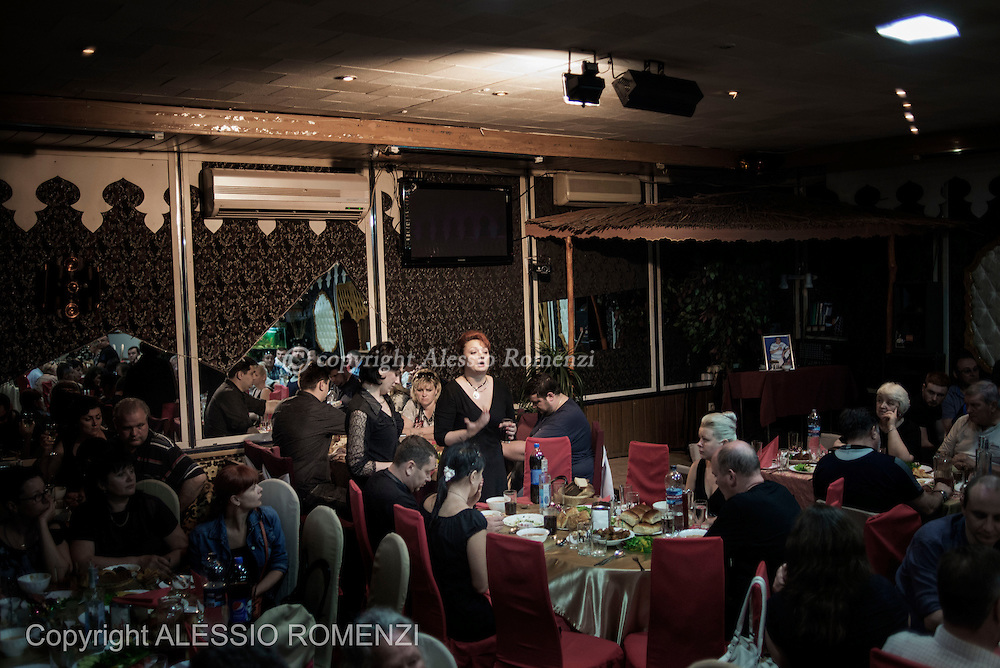 Ukraine, Donetsk: Relative of Mark Zverev's gives a speech at the restaurant where friends of the victim gather after the funeral on May 29, 2014.<br /> Zverev was a taxi driver who has been killed during clashes between pro-Russia supporters and Ukrainian army at Donetsk airport. ALESSIO ROMENZI