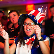"11/06/2012 - Medford/Somerville, Mass. -  Marcy Regalado, A15, celebrates as ""Auntie Sam"" during the election night event at Hotung Cafe on Tuesday, November 6, 2012. (Alonso Nichols/Tufts University)"