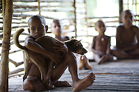 Young Kombai boy with hunting dog. West Papua is home to over 300 tribes. They have inhabited the island for more than 40,000 years. Many of the last remaining tribal cultures on our planet can be found in West Papua. An astounding 15% of the world's languages are spoken there, by just 0.01% of the global population.