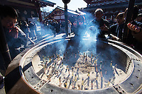 Sensoji is an ancient temple located in Asakusa district of Tokyo and is the city's oldest Buddhist temple. In fact the city of Tokyo grew up around Sensoji and is in the root of its origins.  The centerpiece of Sensoji is the center court, with a giant urn filled with incense.  Japanese direct the  smoke from incense over themselves especially to areas that need healing, like the head for a headache.