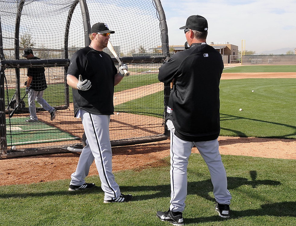 GLENDALE, AZ - FEBRUARY 25:  Adam Dunn #32 (L) talks to hitting coach Greg Walker #29 of the Chicago White Sox looks on during a spring training workout on February 25, 2011 at Camelback Ranch in Glendale, Arizona. (Photo by Ron Vesely)