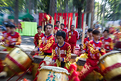 Motion shot of Dragon Dance performers in Ho Chi Minh City, Vietnam, Southeast Asia