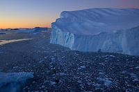 Large iceberg in Cierva Cove, Antarctica, at dusk.