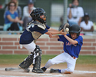 Yankees catcher Brooks Williams (left) takes the throw as the Rangers Ben Harper slides in safely during Oxford Park Commission baseball action at FNC Park in Oxford, Miss. on Monday, April 18, 2011. Monday's games marked the start of the 2011 season.