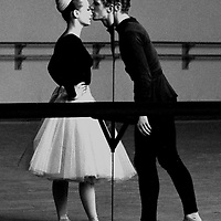 Male and female ballet dancers kissing in mirror of rehearsal room. Taken with a 35 mm Nikon FM.