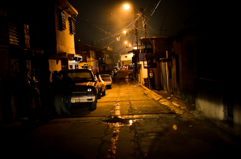 Street scene at night in Petare, a dangerous slum afflicted by drug trafficking violence in Caracas, Venezuela. The White House Office of National Drug Control Policy estimates that as much as 24 percent of the cocaine that left South America in 2010 passed through Venezuela, accounting for up to 203 metric tons. (Archive photo from November 2011, has never been published).