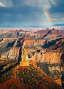 A rainbow ends at the Grand Canyon. From Point Imperial on the North Rim, the highest point in Grand Canyon National Park at 8,803 feet above sea-level. The prominent peak in the foreground is Mount Hayden.