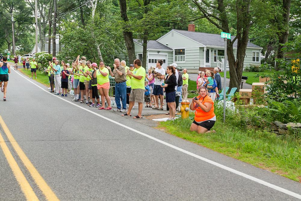 spectators line streets to cheer runners