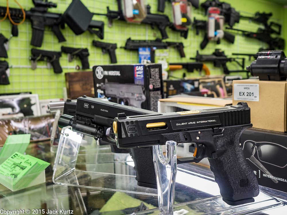 29 SEPTEMBER 2015 - BANGKOK, THAILAND:  Replica guns for sale in the Saphan Lek market. Street vendors and illegal market vendors in the Saphan Lek area will be removed in the next two weeks as a part of an urban renewal project coordinated by the Bangkok Metropolitan Administration. About 500 vendors along Damrongsathit Bridge, popularly known as Saphan Lek, have 15 days to relocate. Vendors who don't move will be evicted. Saphan Lek is just one of several markets and street vending areas being closed in Bangkok this year. The market is known for toy and replica guns, bootleg and pirated DVDs and CDs and electronic toys.   PHOTO BY JACK KURTZ
