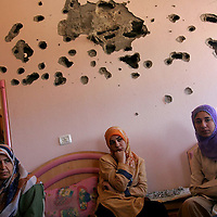 Reema al Ajori, 2nd from left, and her sister Rasha al Ajori, 2nd from right, sit in their bedroom of their home in northern Gaza. The family's home was used by Israeli soldiers during their 2 day offensive in northern Gaza. The girls stayed in the basement while Israeli soldiers occupied their house. At right is their sister Fatma al Ajori. At left is the girl's Aunt Sohyla Radi. July 2006.