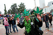 SHOT 4/20/11 5:03:52 PM - Vendors sold paraphernalia and other marijuana themed items as marijuana enthusiasts converged upon Denver, Colorado and Civic Center Park for an event that has come to symbolize Colorado's burgeoning claim as the nation's cannabis capital. Denver's annual April 20th pro-marijuana smoke-out -- known as the 420 Rally -- is reputedly the largest of its kind in the world on a day that has come to be regarded as a ganja holiday. The crowd was estimated at about 10,000 participants and the signature moment of the rally occurred at 4:20 p.m., when participants collectively lit up and a thick cloud of marijuana smoke rose over the park within site of the state capital. Organizers say the goal of the rally is to bring people together to protest peacefully marijuana prohibition. Includes images of event organizer Miguel Lopez..(Photo by Marc Piscotty / © 2011)