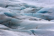 View of the Svínafellsjökull glacier that pours down from the Vatnajökull glacier, Europe's largest. At the foot of the glacier a lake has formed, in which icebergs calve and float to the shore.