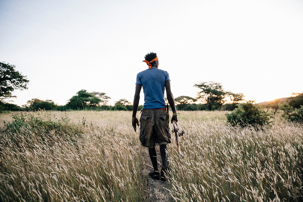 Benja, 20, a member of the Hadza tribe, goes hunting in the Yaeda valley area in Northern Tanzania. Photo by Greg Funnell, March 2016.