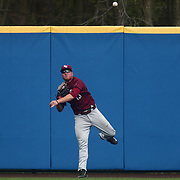 Saint Joseph's Outfielder John Brue (13) throws the ball to second base after catching a fly ball in center field during a regular season baseball game between Delaware and Saint Joseph's at Bob Hannah Stadium Tuesday April 19, 2016, in Newark.