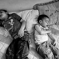 Egypt / Syrian refugees / Two young Syrian refugees sleep on a mattress in the living room of a small apartment in the impoverished Masaken Osman neighborhood in the 6th of October City outside of Cairo, Egypt, Monday, May 27, 2013. The neighborhood is a mix of lower income Egyptian families and hundreds of newly arrived Syrian refugees. Many Syrians in the neighborhood prefer to stay in their homes.  / UNHCR / Shawn Baldwin / May 2013