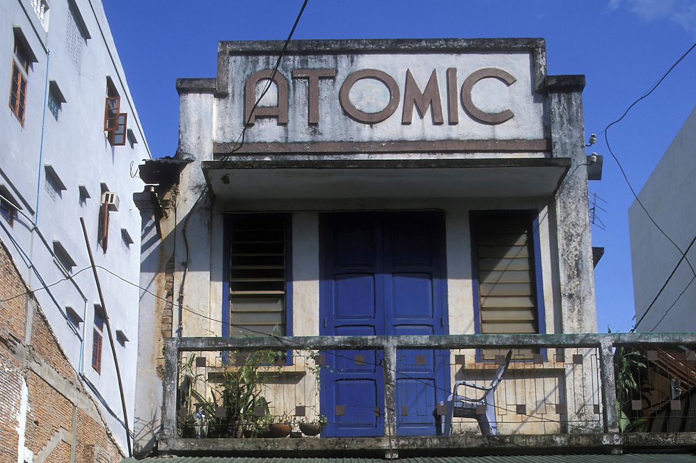 Asia, Laos, Vientiane, Atomic Cafe sign along streets on summer afternoon