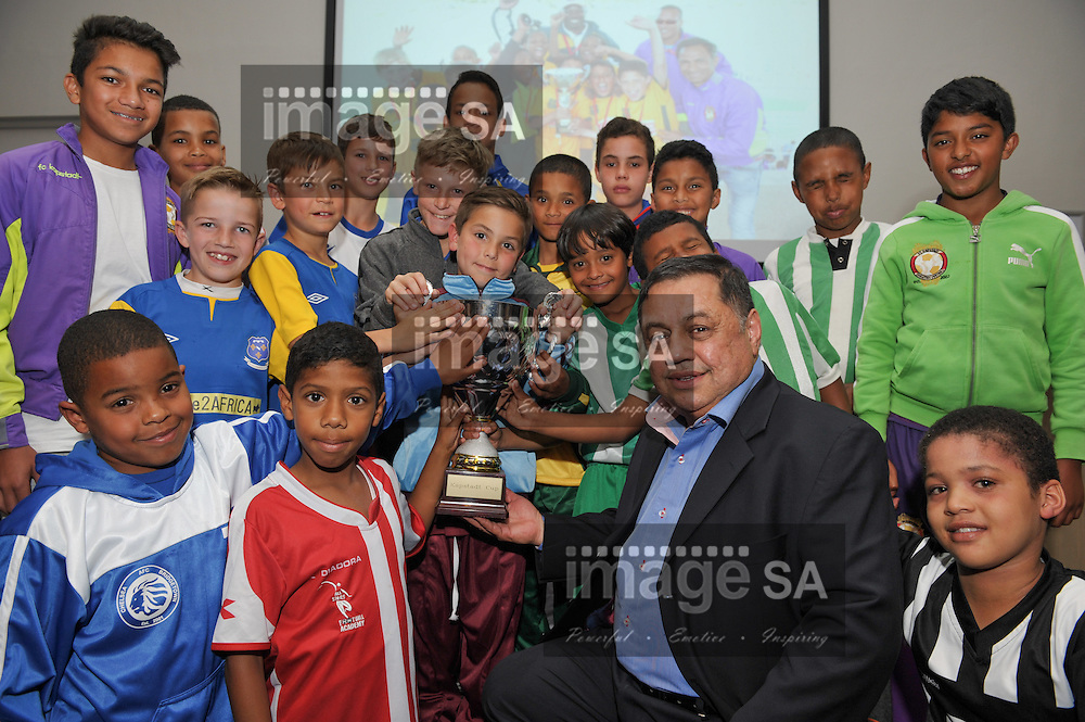 CAPE TOWN, SOUTH AFRICA - OCTOBER 14 2015, Mr Hassen Kagee, Director of Nexia SAB &amp;T with some of the young players during the draw of the FC Kapstadt Cup at The River Club in Observatory.<br /> Photo by Roger Sedres/ImageSA