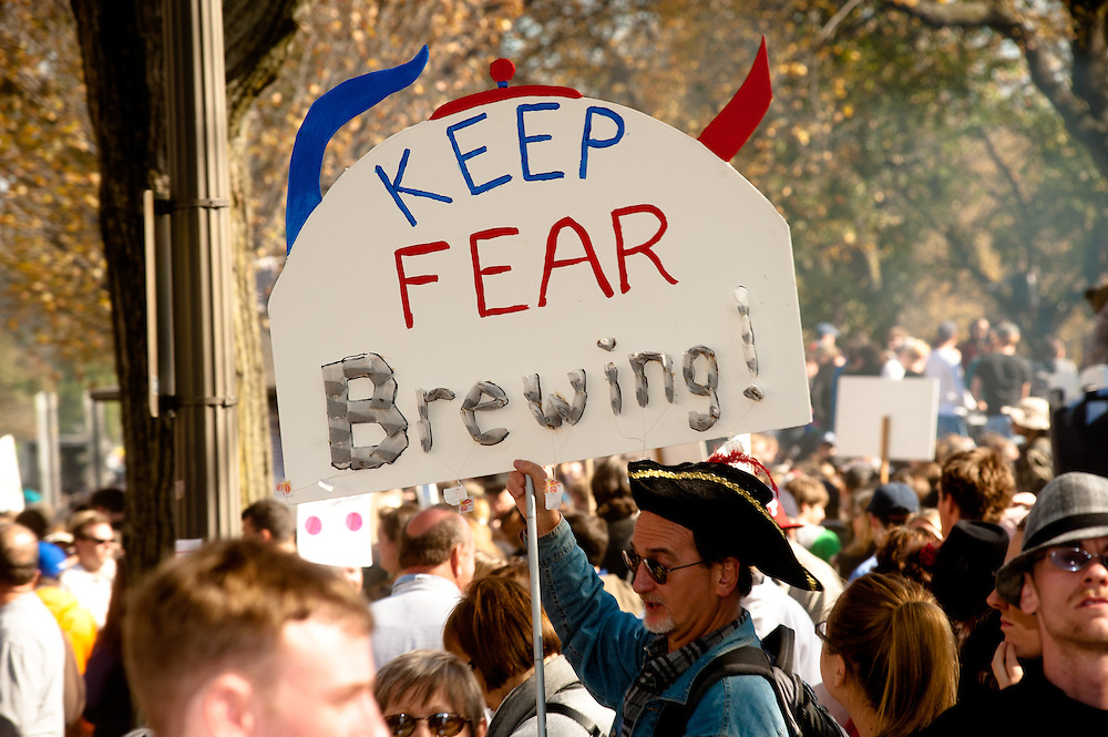 "Washington, DC, October 30, 2010 - Jon Stewert and Steven Colbert host the Rally To Restore Sanity and/or Fear.  Tens of thousands of ralliers donned costumes and carried signs. ""KEEP FEAR BREWING"""