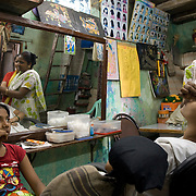 Tasleem Beauty Parlor is one of many local beauty parlors operating out of a family home in Dharavi.   Zarena (35) named the parlor after her oldest daughter. Mumbai, August 2007