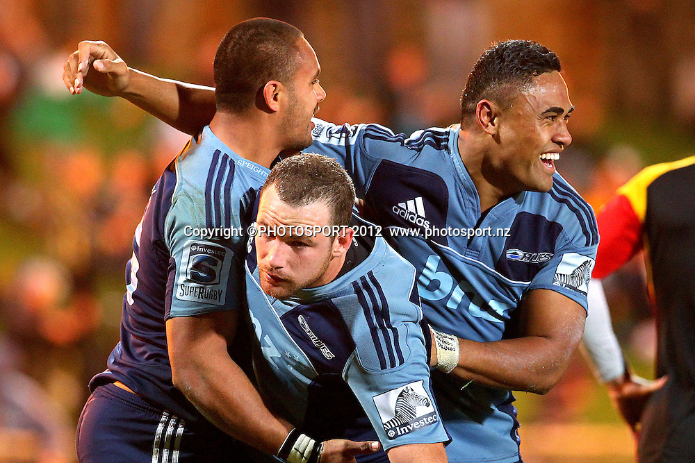 Blues' Rudi Wulf celebrates his try with Francis Saili and Alby Mathewson. Super Rugby rugby union match, Blues v Chiefs at North Harbour Stadium, Auckland, New Zealand. Saturday 2nd June 2012. Photo: Anthony Au-Yeung / photosport.co.nz
