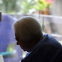 A woman with Alzheimer's disease rests at ia live-in residence for Alzheimer's and dementia related  patients.