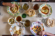 breakfast in a shop in Pettah. String hoppers, paratha, curries. Pettah, Colombo