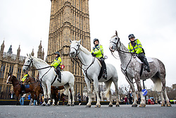 © Licensed to London News Pictures. 29/03/2017. London, UK. Mounted police wait on Westminster Bridge, as people gather in memory of those involved in the terror attack in Westminster one week ago, when attacker Khalid Masood drove a car into pedestrians on Westminster Bridge, and murdered police officer Keith Palmer. Photo credit : Tom Nicholson/LNP