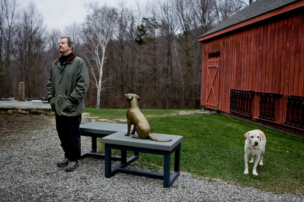 KENT, CT-December 2, 2009: American sculptor Daniel Murray and his Labrador Retriever Bosun photographed at his home in Kent, Connecticut. The artist and former actor works mostly with cast bronze as seen in the sculpture of the puppy. (Photo by Robert Falcetti)