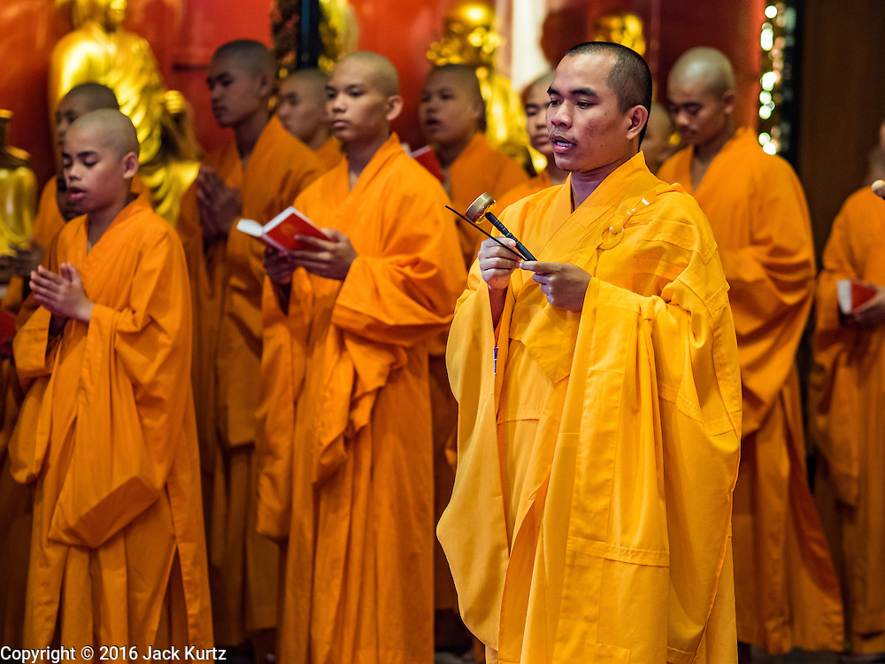 "07 FEBRUARY 2016 - BANGKOK, THAILAND: Mahayana novices (young monks) at Wat Mangon Kamlawat, perform a religious ceremony for Chinese New Year. Chinese New Year, also called Lunar New Year or Tet (in Vietnamese communities) starts Monday February 8. The coming year will be the ""Year of the Monkey."" Thailand has the largest overseas Chinese population in the world; about 14 percent of Thais are of Chinese ancestry and some Chinese holidays, especially Chinese New Year, are widely celebrated in Thailand.        PHOTO BY JACK KURTZ"