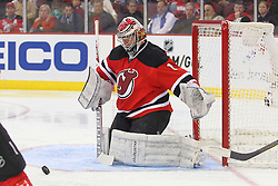 Mar 13, 2013; Newark, NJ, USA; New Jersey Devils goalie Johan Hedberg (1) makes a save during the second period of their game against the Philadelphia Flyers at the Prudential Center.