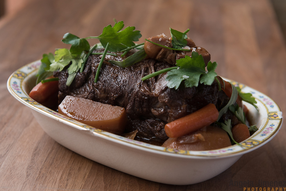 Date: 1/11/16<br /> Desk: DIN<br /> Slug: POT ROAST<br /> Assign Id: 30184022A<br /> <br /> Gavin Kaysen, chef and owner at Spoon and Stable restaurant in Minneapolis, Minnesota, makes his Dorothy's Pot Roast ($28 on the Land section of the dinner menu) based on his Minnesotan grandmother Dorothy Kaysen's recipe, as photographed on January 11, 2016. This is the full roast presented in a dish. <br /> <br /> Photo by Angela Jimenez for The New York Times <br /> photographer contact 917-586-0916