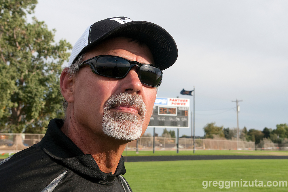 Vale coach Rick Yraguen takes the field before the start of the Vale - Parma football game, September 4, 2015 at Parma High School, Parma, Idaho. Vale won 31-10.