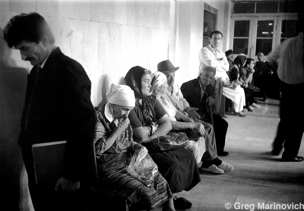 IPMG0839 Grozny, Chechnya, 1995: Chechens wait hours to see administrators and/or bureaucrats in the devestated capital of Chechnya, Grozny, July 1995.  Russian bombing left very few buildings in the centre intact during a bloody war. Russia agreed to grant autonomy after Chechens retook several towns and the capital Grozny in 1995, after a bloody war for Chechen independence.  The Chechens are Moslem and have a strong sense of national identity.  Their fight for independence from Russia has increased an Islamic militancy and  identity. <br /> Photograph by Greg Marinovich/South Photographs