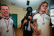 Player of the Czech Goalball Team holding his guiding dog up in his arms during a ceremony getting the first price for winning the international Goalball tournament in Zagreb. Goalball is a team sport designed for blind and visually impaired athletes. It was devised by an Austrian, Hanz Lorenzen, and a German, Sepp Reindle, in 1946 in an effort to help in the rehabilitation of visually impaired World War II veterans. The International Blind Sports Federatgion (IBSA - www.ibsa.es), responsible for fifteen sports for the blind and partially sighted in total, is the governing body for this sport.