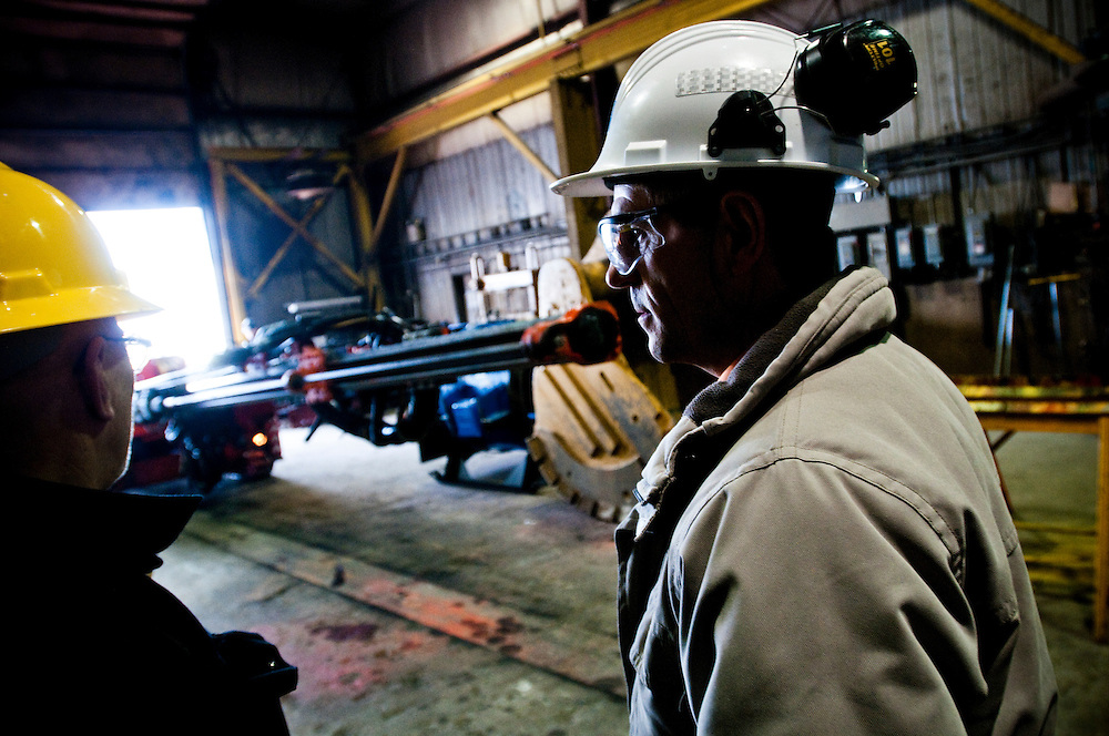 Sandvik salesman Georges Jr Bernier using the Solid Ground Magazine while meeting clients at various mines in Quebec....Photographer: Chris Maluszynski /MOMENT
