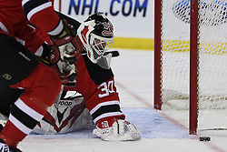 Mar 25, 2010; Newark, NJ, USA; New Jersey Devils goalie Martin Brodeur (30) watches the puck slide wide of the goal during the second period at the Prudential Center.