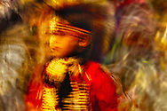 Crow Fair, powwow, Young Traditional Dancer, Crow Indian Reservation, Montana, blurred motion