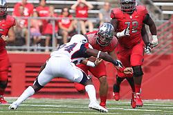 Sept 8, 2012; Piscataway, NJ, USA; Howard Bison defensive back Julien David (24) tackles Rutgers Scarlet Knights quarterback Gary Nova (15) during the first half at High Point Solutions Stadium.