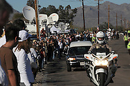 The funeral of Christina-Taylor Green, 9, who was shot to death along with five others, in an assassination attempt on congresswoman Gabrielle Giffords outside a Safeway store, took place on January 13, 2011.  Numerous others were injured in the shooting spree.