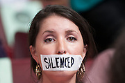July 25, 2016 - Philadelphia, Pennsylvania: A Wisconsin delegate sits with tape over her mouth and the word silenced written on the tape.