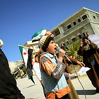 Anti government demonstrators rally and march for regime change and peace in the town of Al Janoudiyah, Syria.