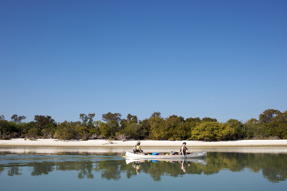 Canoeists paddling on calm morning on Gullivan Bay in the Everglades