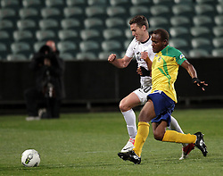 New Zealand's Chris Killen races Solomon Islands' Jeffery Bule to the ball in a FIFA World Cup Qualifier Match, North Harbour Stadium, Auckland, New Zealand, Tuesday, September 11, 2012.  Credit:SNPA / David Rowland