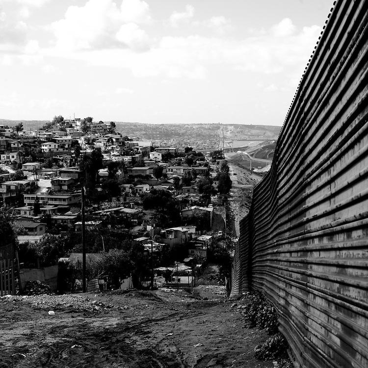 A metal fence separates Tijuana, Baja California, Mexico, from southern California on Monday, Feb. 4, 2008.