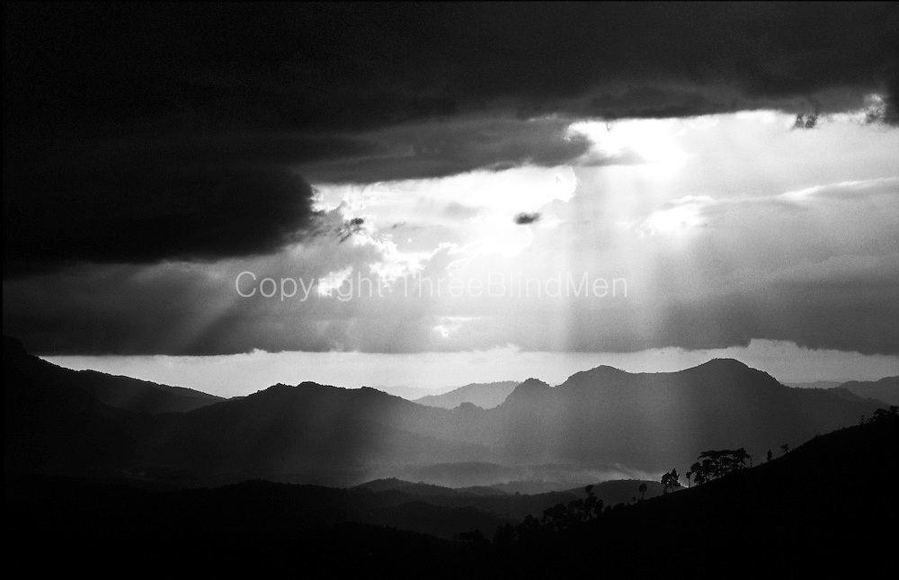 Sunburst over the Matale Hills and Valley taken from the road between Rattota and Illukkumbara..Easter 2001.