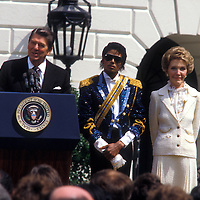 "Michael Jackson receives a White House welcome in May 1984 from President and Mrs. Reagan to receive a commendation for his work against teens and drunk driving. ""Isn't this a thriller?"" President Reagan commented."