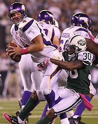 Oct 11, 2010; East Rutherford, NJ, USA; New York Jets cornerback Drew Coleman (30) sacks Minnesota Vikings quarterback Brett Favre (4) during the first half at the New Meadowlands Stadium.