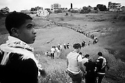 Walking through tobacco fields to the top of Maroun Al Rass. Tens of thousands of Palestinians and their supporters gathered at the border town of Maroun Al Rass to commemorate 63 years since the Nakba or catastrophe. Palestinians commemorate on May 15 the loss of their homeland. The Lebanese army stated that 10 protesters died due to gunshot wounds by the Israeli army and 112 were wounded.  Maroun Al Rass, Lebanon, May 15, 2011. OMAR YASHRUTI/PI, PRENSA-INTERNACIONAL.COM