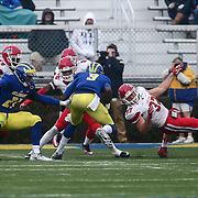 Stony Brook linebacker JOHN HAGGART (37), RIGHT, attempts to tackle the quarterback during a week eight game between the Delaware Blue Hens and the Stony Brook Seawolves, Saturday, Oct. 22, 2016 at Tubby Raymond Field at Delaware Stadium in Newark, DE.